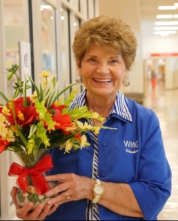 volunteer holding a bouquet of flowers